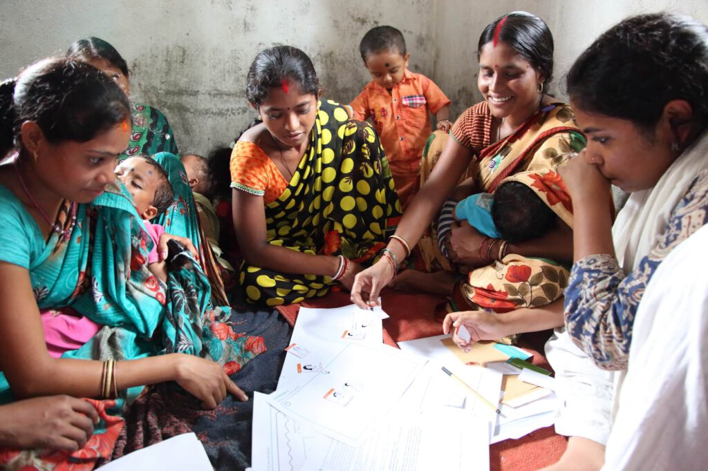 Women sit in circle to discuss improving maternal health services