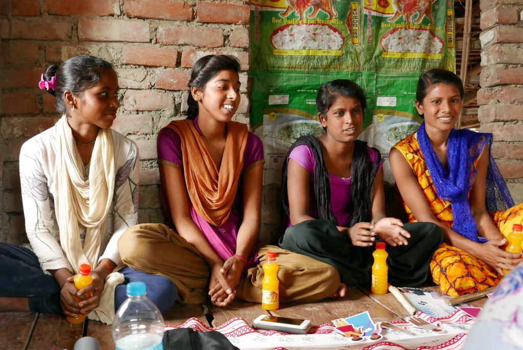 A group of adolescent women are discussing their role, experiences, and expectations of womanhood and reproductive health..