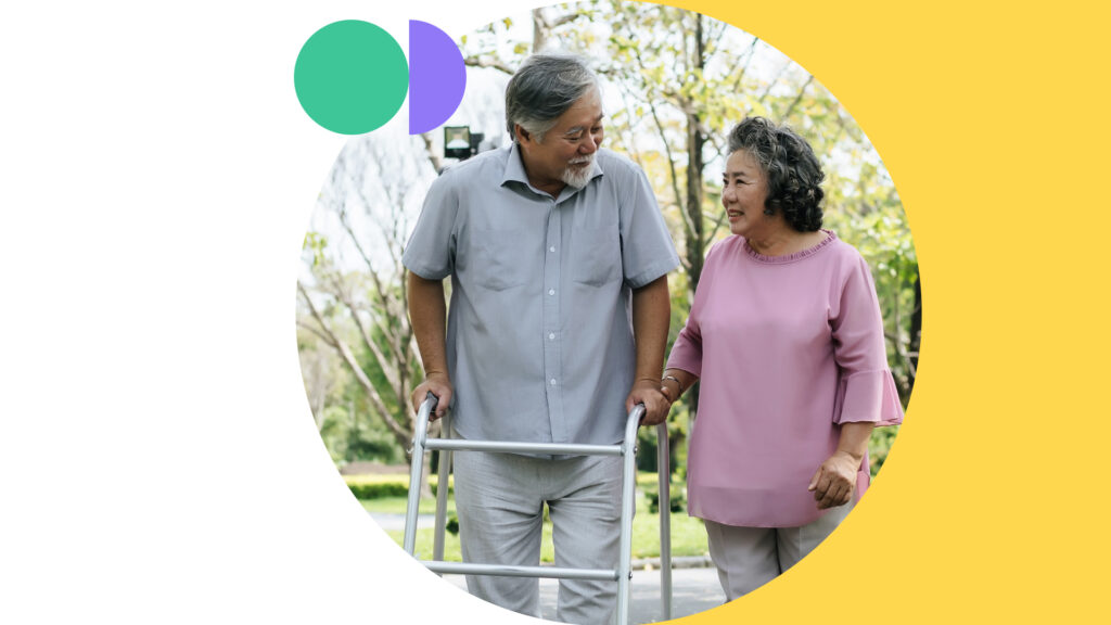The Missing Billion is advocating for health equality for persons with disabilities. An elderly couple are taking a walk in a park. They are smiling and looking at each other. The man is leaning on a walker in front of him, while his spouse is holding her hand on the walker.