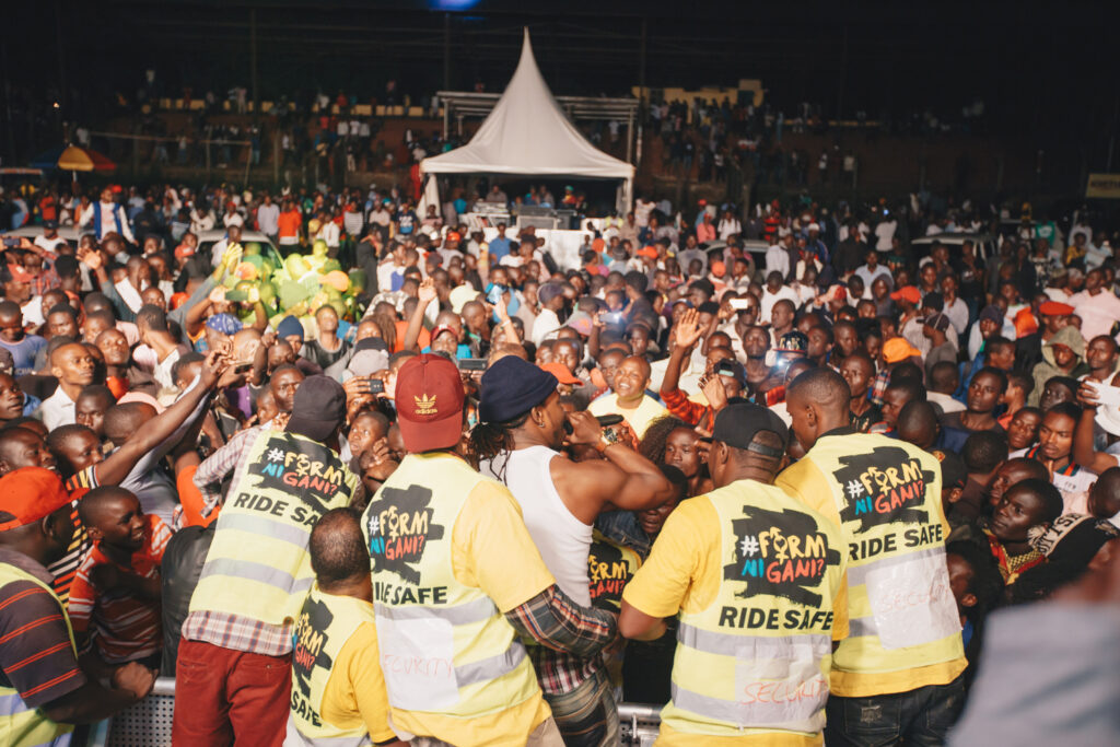 A big crowd attending a #FormNiGani concert in 2018. At the front security personnel are wearing vests with the movement's logo and text 'Safe ride'
